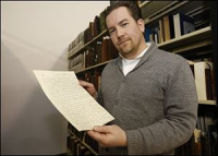 Cheney Schopieray, curator of manuscripts for the Clements Library at the University of Michigan, holds a letter from Gen. Henry Burbeck to Lt. James Rhea. THE BLADE/JETTA FRASER